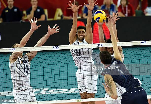 Jose Luis Gonzalez and Sebastian Sole of Argentina block during the FIVB World Championships match between Argentina and USA on September 14 2014 in...