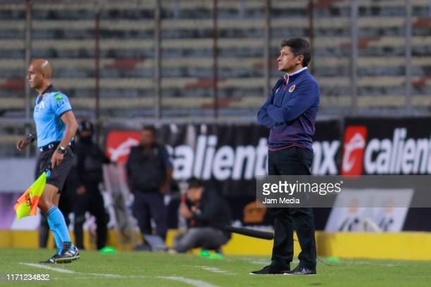Jose Luis Gonzalez China Head Coach of Veracruz observes the game during the 8th round match between Morelia and Veracruz as part of the Torneo...