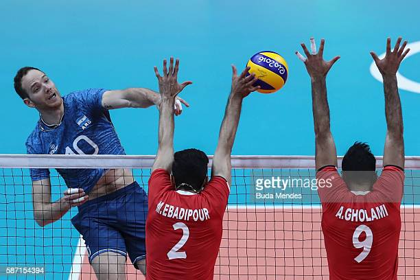 Jose Luis Gonzalez of Argentina jumps to spike the ball against Milad Ghara of Iran during the Men's Preliminary Pool A match between theArgentina...
