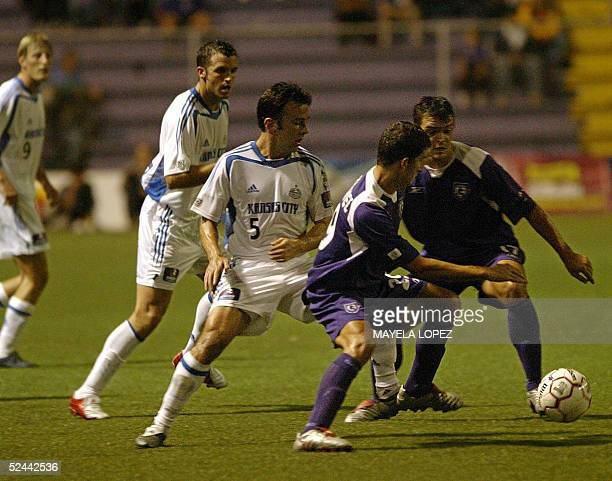 Jose Luis Lopez and Juan Lobo from Costa Rica Deportivo Saprissa steal the ball from Kerry Zavagnin from Kansas City Wizards 17 March 2005 at the...