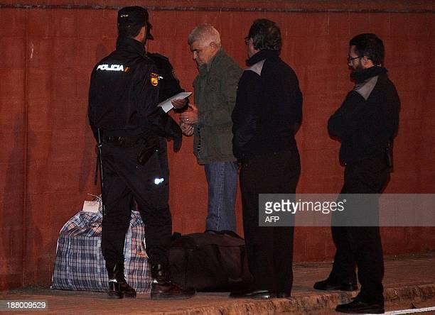 Jose Luis Lopez Ruiz also known as Kubati member of Basque armed separatist group ETA speaks with police officers as he leaves the Puerto I prison in...