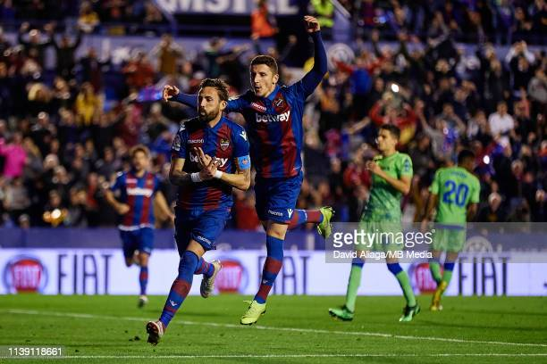 Jose Luis Morales Nogales of Levante UD celebrates his sides third goal with his teammate Enis Bardhi during the La Liga match between Levante UD and...