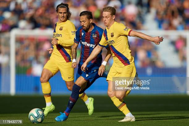 Jose Luis Morales Nogales of Levante UD competes for the ball with Frenkie de Jong and Antoine Griezmann of FC Barcelona during the Liga match...