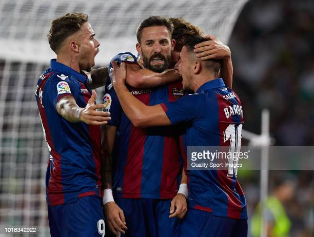 Jose Luis Morales of Levante celebrates after scoring his side second goal with his teammates during the La Liga match between Real Betis Balompie...