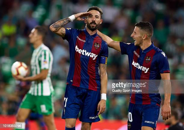Jose Luis Morales of Levante celebrates after scoring his team's third goal with his teammate Enis Bardhi during the La Liga match between Real Betis...