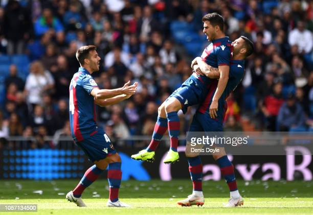 Jose Luis Morales of Levante celebrates with team mates after scoring his sides first goal during the La Liga match between Real Madrid CF and...