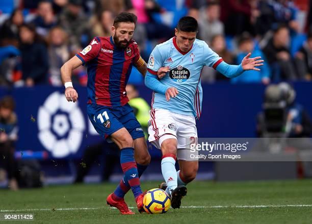 Jose luis Morales of Levante competes for the ball with Facundo Roncaglia of Celta de Vigo during the La Liga match between Levante and Celta de Vigo...