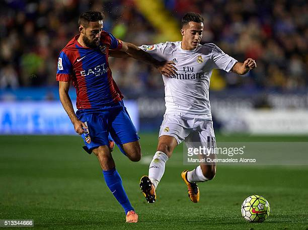 Jose luis Morales of Levante competes for the ball with Lucas Vazquez of Real Madrid during the La Liga match between Levante UD and Real Madrid at...