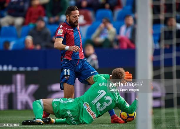 Jose luis Morales of Levante competes for the ball with Ruben Blanco of Celta de Vigo during the La Liga match between Levante and Celta de Vigo at...