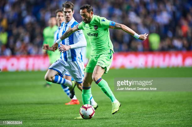 Jose Luis Morales of Levante UD being followed by Aritz Elustondo of Real Sociedad during the La Liga match between Real Sociedad and Levante UD at...