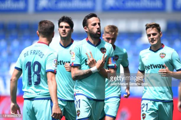 Jose Luis Morales of Levante UD celebrates after scoring their team's first goal during the La Liga Santander match between Deportivo Alavés and...