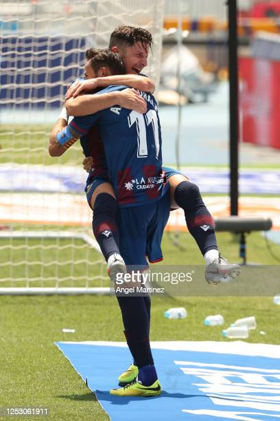 Jose Luis Morales of Levante UD celebrates with Enis Bardhi after scoring his team's third goal during the La Liga match between Levante UD and Real...