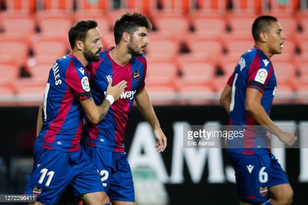 Jose Luis Morales of Levante UD celebrates with his team mate Gonzalo Melero of Levante UD after scoring his team's first goal during the La Liga...