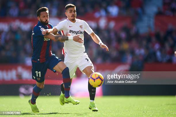 Jose Luis Morales of Levante UD competes for the ball with Andre Silva of Sevilla FC during the La Liga match between Sevilla FC and Levante UD at...