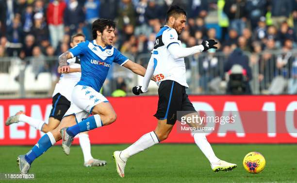 Jose Luis Palomino of Atalanta BC is challenged by Sandro Tonali of Brescia Calcio during the Serie A match between Brescia Calcio and Atalanta BC at...