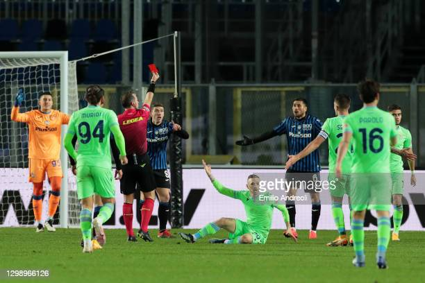 Jose Luis Palomino of Atalanta B.C. Is shown a red card by match referee, Luca J. Pairetto during the Coppa Italia match between Atalanta BC and SS...