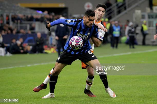Jose Luis Palomino of Atalanta competes for the ball with Carlos Soler of Valencia CF during the UEFA Champions League round of 16 first leg match...