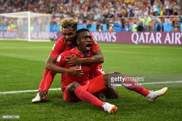 Jose Luis Rodriguez of Panama celebrates with teammate Ricardo Avila his team's first goal an own goal by Yassine Meriah of Tunisia during the 2018...