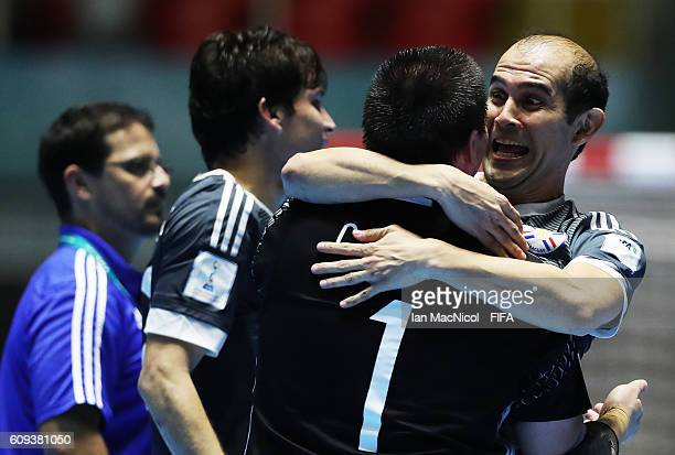 Jose Luis Santander celebrates with Carlos Espinola as Paraguay win a penalty shoot out during the FIFA Futsal World Cup Round of 16 match between...