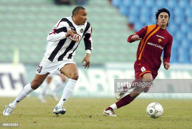 Jose Luis Vidigal of Udinese is tracked by Alberto Aquilani of Roma during the Serie A match between Udinese and AS Roma at the Stadio Friuli on...