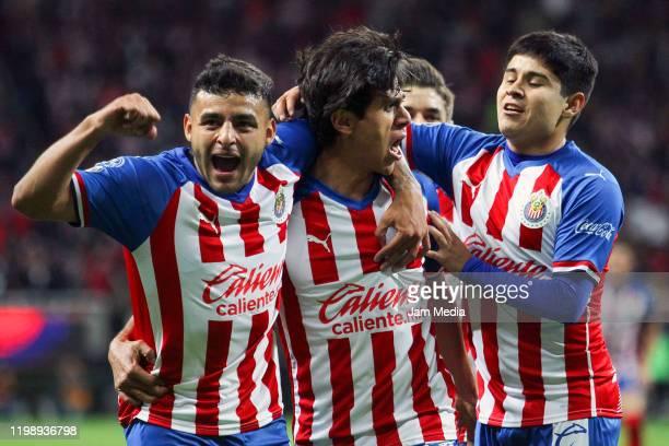 Jose Macias of Chivas celebrates after scoring the second goal of his team with teammates Ernesto Vega and Javier Eduardo Lopez during the 1st round...