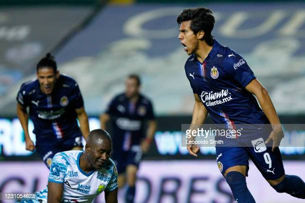 Jose Macias of Chivas celebrates after scoring the second goal of his team during a match between Leon and Chivas as part of Torneo Guard1anes 2021...