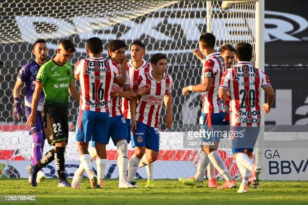 Jose Macias of Chivas celebrates with teammates after scoring the first goal of his team during the 4th round match between FC Juarez and Chivas as...