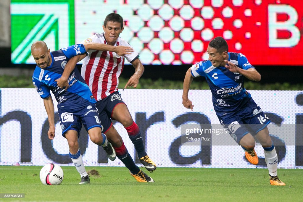 Jose Macias of Chivas fights for the ball with Francisco Acuña of Puebla during the fifth round match between Chivas and Puebla as part of the Torneo Apertura 2017 Liga MX at Chivas Stadium on August 19, 2017 in Zapopan, Mexico.
