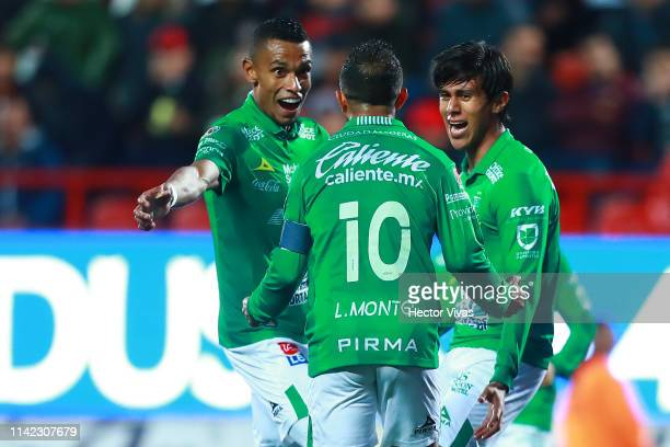 Jose Macias of Leon celebrate with teammates after scoring the first goal of his team during the quarterfinals first leg match between Tijuana and...