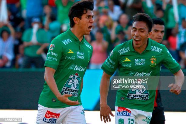 Jose Macias of Leon celebrates with teammate Angel Mena his goal against Atlas during a Mexican Clausura 2019 tournament football match at the Nou...
