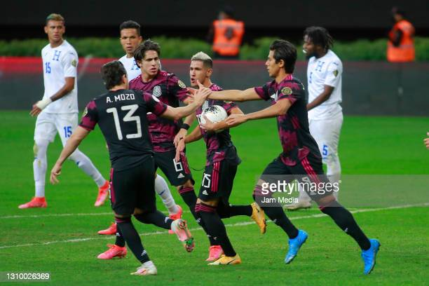 Jose Macias of Mexico celebrates with teammates after scoring the first goal of his team during the final match between Honduras and Mexico as part...
