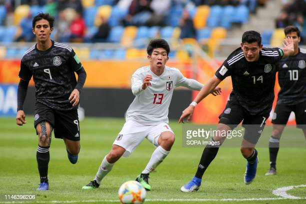 Jose Macias Oswaldo Leon from Mexico and Taisei Miyashiro from Japan are seen in action during the FIFA U20 World Cup match between Mexico and Japan...