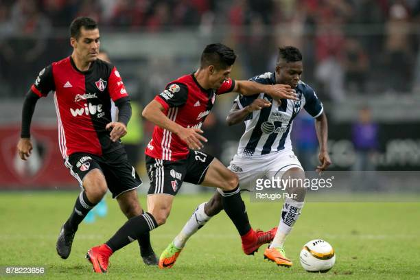 Jose Maduena of Atlas fights for the ball with AvilŽes Hurtado of Monterrey during the quarter finals first leg match between Atlas and Monterrey as...