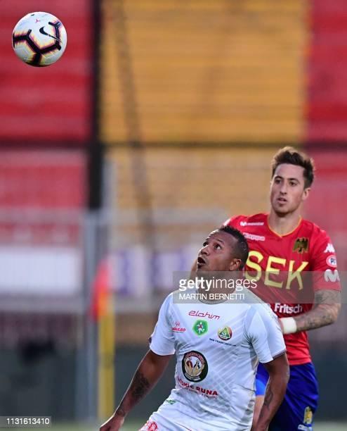 Jose Manuel Aja of Chile's Union Espanola vies for the ball with Alex Cedeno of Ecuador's Mushuc Runa during their Copa Sudamericana football match...