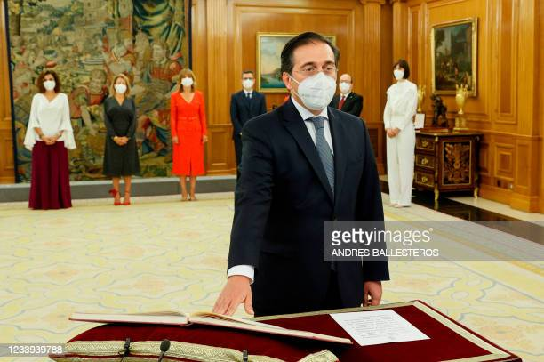 Jose Manuel Albares takes his oath of office as Spain's new Foreign minister during the swearing in ceremony at the Zarzuela Palace in Madrid on July...