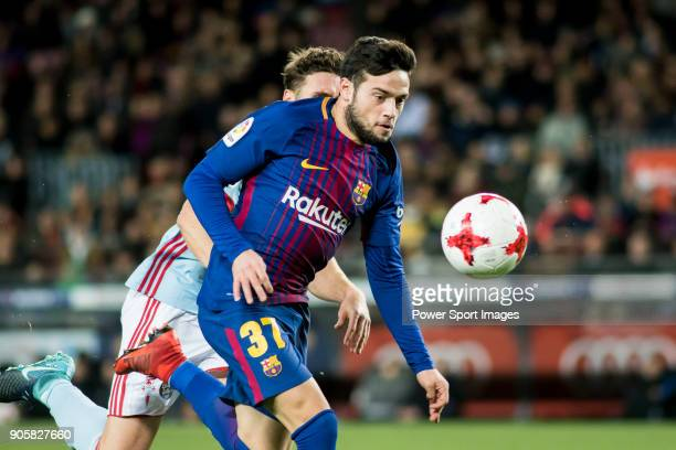 Jose Manuel Arnaiz Diaz of FC Barcelona fights for the ball with Sergi Gomez Sola of RC Celta de Vigo during the Copa Del Rey 201718 Round of 16...