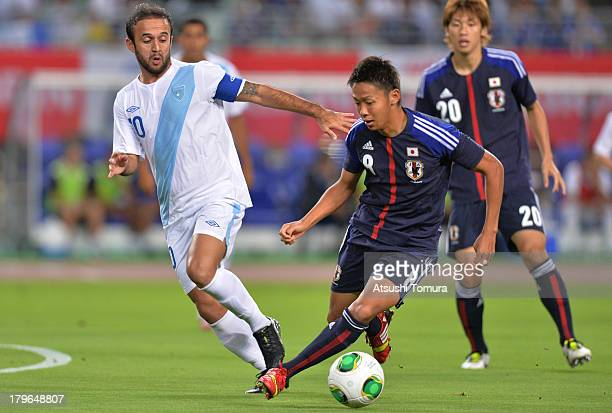Jose Manuel Contreras of Guatemala and Hiroshi Kiyotake of Japan in action during the international friendly match between Japan and Guatemala at...