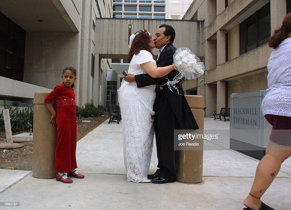 Jose Manuel Espinoza Kisses His New Bride Laura After A Quick Wedding Ceremony February 14