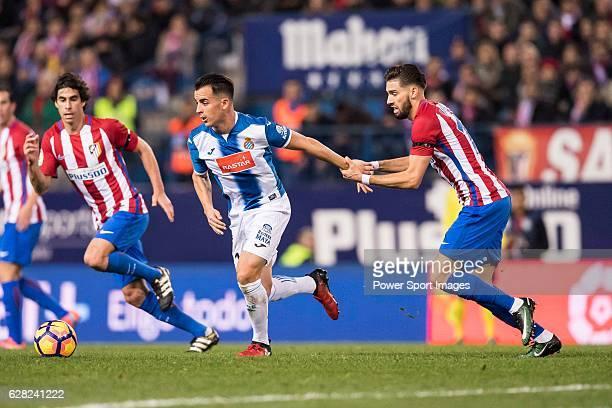 Jose Manuel Jurado Marin of RCD Espanyol battles for the ball with Yannick Ferreira Carrasco of Atletico de Madrid during the La Liga match between...