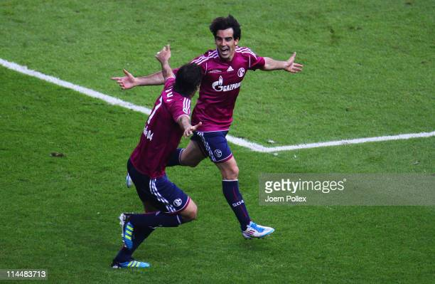 Jose Manuel Jurado Marin of Schalke celebrates with his team mate Raul after scoring his team's fourth goal during the DFB Cup final match between...