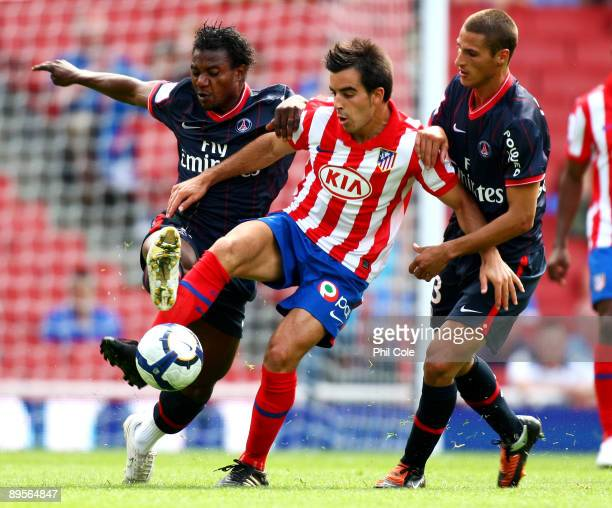 Jose Manuel Jurado of Athletico holds off the challenges from Stephane Sessegnon and Jeremy Clement of PSG during the Emirates Cup match between...