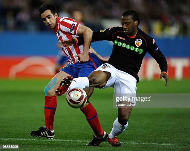 Jose Manuel Jurado of Atletico Madrid duels for the ball with Manuel Fernandes of Valencia during the UEFA Europa League quarter final second leg...
