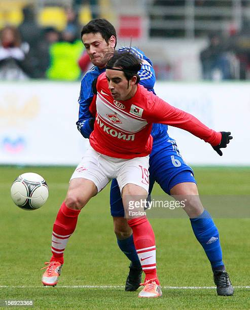 Jose Manuel Jurado of FC Spartak Moscow battles for the ball with Leandro Fernandez of FC Dynamo Moscow during the Russian Premier League match...