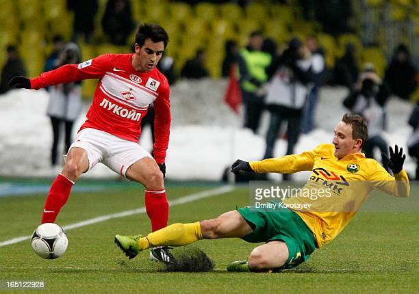 Jose Manuel Jurado of FC Spartak Moscow battles for the ball with Aleksei Kozlov of FC Kuban Krasnodar during the Russian Premier League match...