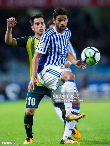 Jose Manuel Jurado of RCD Espanyol duels for the ball with Willian Jose Da Silva of Real Sociedad during the La Liga match between Real Sociedad de...