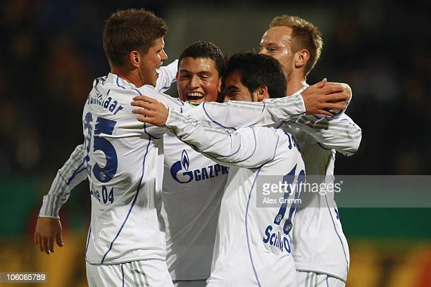 Jose Manuel Jurado of Schalke celebrates his team's first goal with team mates KlaasJan Huntelaar Kyriakos Papadopoulos and Ivan Rakitic during the...