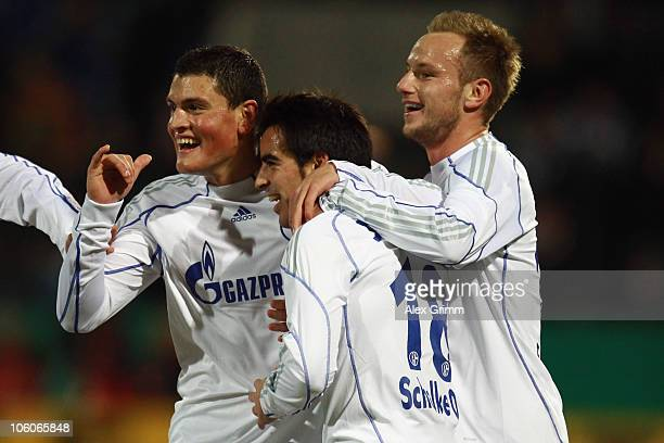 Jose Manuel Jurado of Schalke celebrates his team's first goal with team mates Kyriakos Papadopoulos and Ivan Rakitic during the DFB Cup second round...