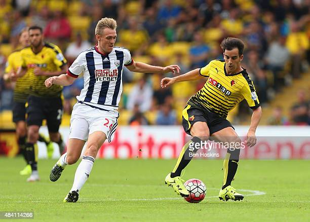 Jose Manuel Jurado of Watford and Darren Fletcher of West Bromwich Albion compete for the ball during the Barclays Premier League match between...