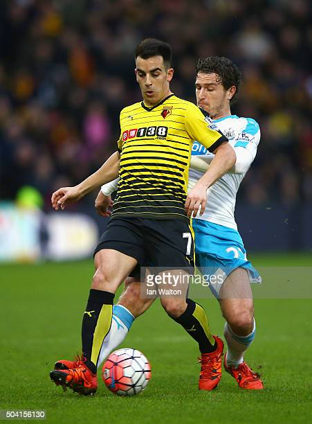 Jose Manuel Jurado of Watford and Daryl Janmaat of Newcastle United compete for the ball during the Emirates FA Cup Third Round match between Watford...