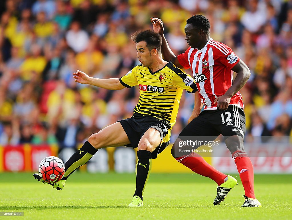 Jose Manuel Jurado of Watford is closed down by Victor Wanyama of Southampton during the Barclays Premier League match between Watford and Southampton at Vicarage Road on August 23, 2015 in Watford, England.